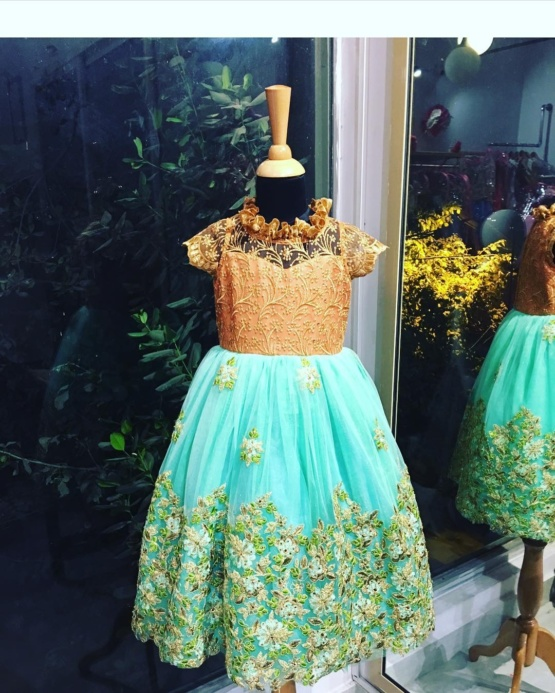 green and brown baby frock with a lace base and stones