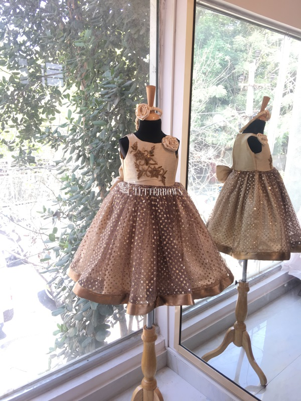 A creamy bodice with an embroidered patch baby girl dresses