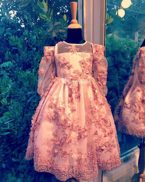 A handwork pastel pink girls dress with flower applique
